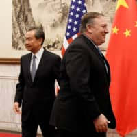 U.S. Secretary of State Mike Pompeo and Chinese State Councilor and Foreign Minister Wang Yi prepare to hold a meeting in Beijing in 2018.  | POOL / VIA REUTERS