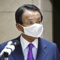 Japan's low virus deaths reflect high 'cultural standards,' says Taro Aso