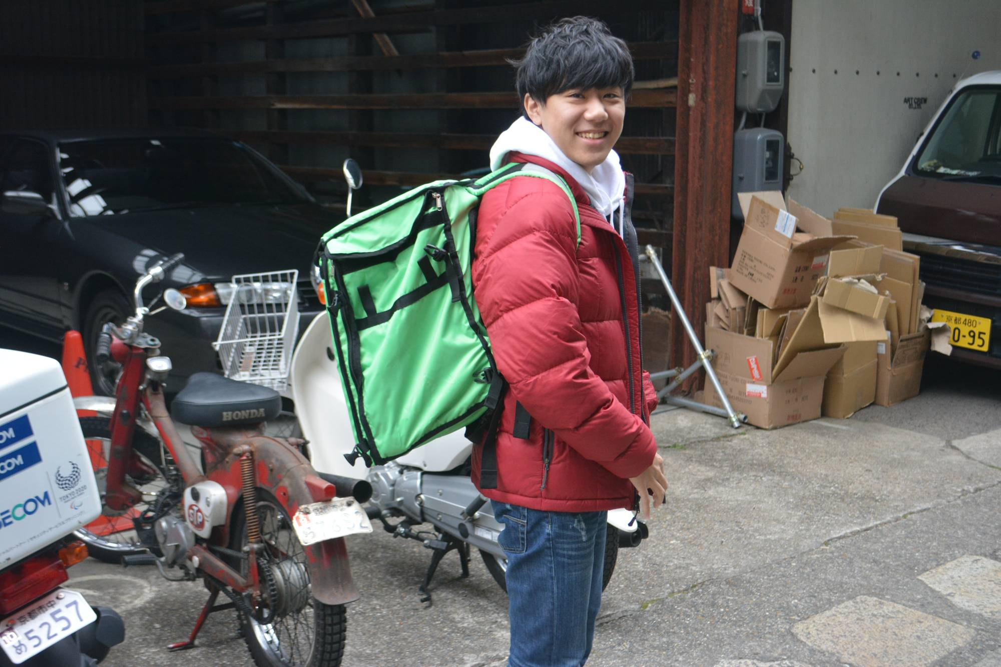 Gig economy: University student Yuya Suzuki started delivering for Uber Eats during the pandemic when the cram school he worked at shut down. | J.J. O'DONOGHUE