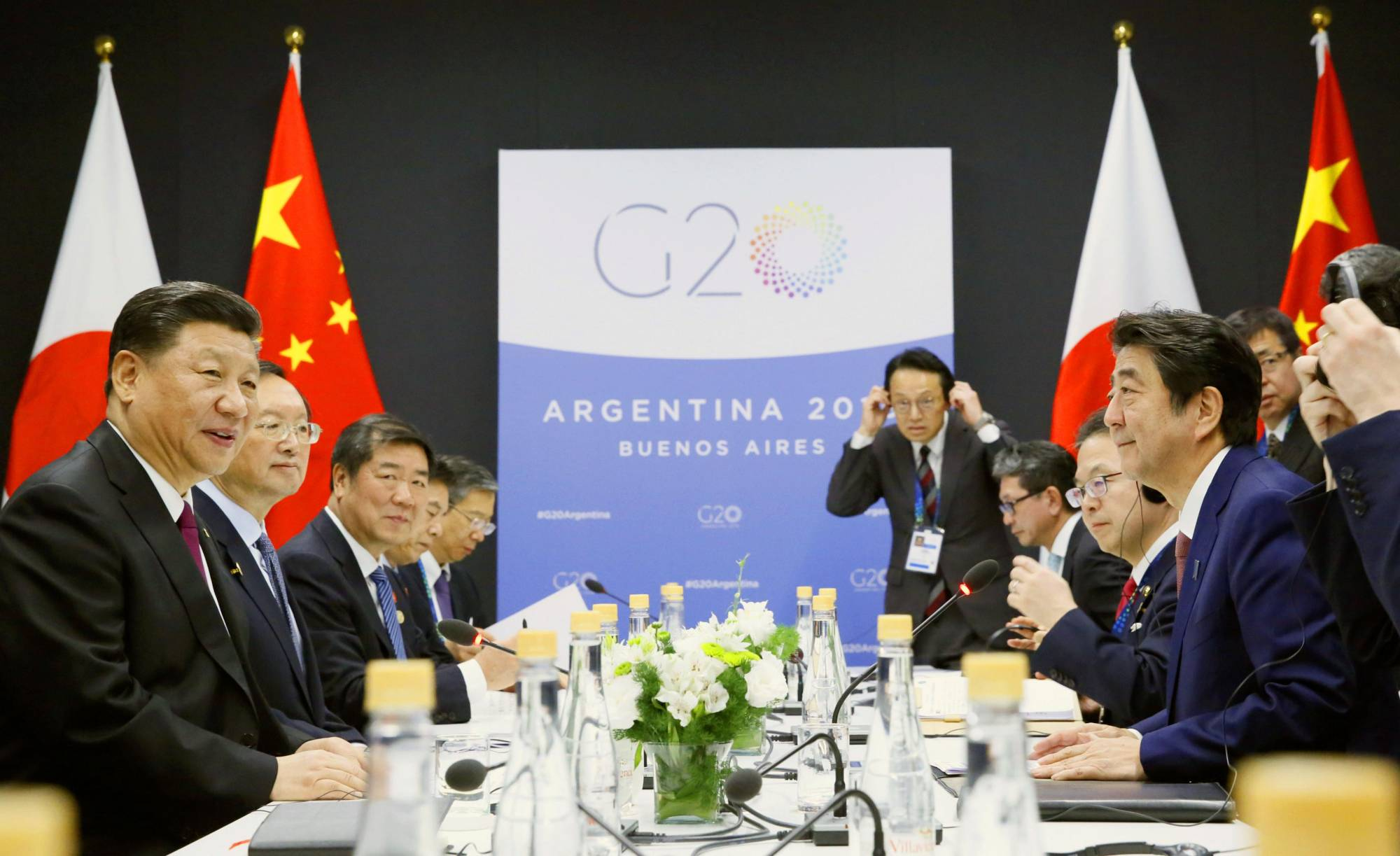 Chinese leader Xi Jinping and Prime Minister Shinzo Abe hold bilateral talks in December 2018 on the sidelines of the Group of 20 leaders' summit in Buenos Aires. | KYODO