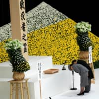 Emperor Naruhito and Empress Masako bow during a memorial service ceremony marking the 74th anniversary of Japan's surrender in World War II, in Tokyo on Aug. 15. | REUTERS