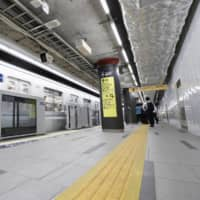 A subway train passes newly built Tokyo Metro's Toranomon Hills Station on the subway Hibiya Line Tuesday ahead of its opening Saturday. | KYODO
