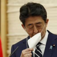 The 38.1 percent public approval rate for Prime Minister Shinzo Abe's Cabinet in May is overshadowed by its 61.3 percent disapproval rate, the results of a Jiji Press survey released Saturday say. | AP