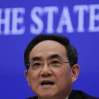 Xu Lin, head of State Council Information Office, speaks during a news conference in Beijing on Sunday.  | AP