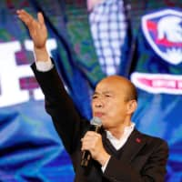 Kuomintang presidential candidate Han Kuo-yu speaks to his supporters at an election rally in Taichung, Taiwan, in December. | REUTERS