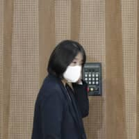 Yoon Mee-hyang arrives for a news conference at the National Assembly in Seoul on May 29. | AP
