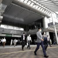 Mergers are beginning to pick up in Japan after slumping to a 10-year low in April amid coronavirus outbreak. | BLOOMBERG