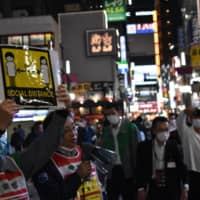 Tokyo officials call for social distancing Friday in Kabukicho, a red-light district in Shinjuku Ward, following reports that some new infections in the capital have been linked to nightclub workers. | TOMOHIRO OSAKI