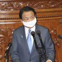 Finance Minister Taro Aso addresses the Lower House plenary session Monday. | KYODO