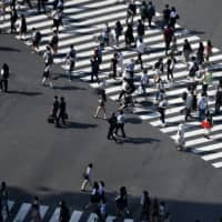 Business sentiment among workers in Japan with jobs sensitive to economic trends rose in May for the first time in four months, as the country gradually emerges from the fallout from the pandemic. Still, it is the third-lowest reading. | AFP-JIJI