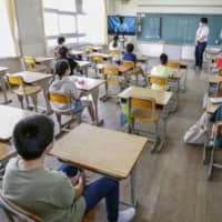 Students sit apart from each other at an elementary school in the city of Nara on June 1 after the school reopened. | KYODO
