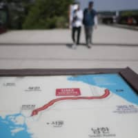 A map of the two Koreas shows the Demilitarized Zone, in Paju, South Korea. Pyongyang said on Tuesday it will sever hotlines with South Korea as a first step toward shutting down all contact with Seoul | AP