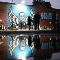Thousands pay tribute to George Floyd as pressure mounts for U.S. police reform