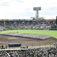Players participate in the opening ceremony of the 2019 National High School Baseball Championship on Aug. 6 at Koshien Stadium in Nishinomiya, Hyogo Prefecture. | KYODO