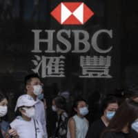 Analysts estimate only around 30 percent of bank staff in Hong Kong can effectively work from home at any one time, meaning a return to the office may be necessary for most. | BLOOMBERG