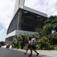 The tower of the underground district cooling network operated by SP Group's Singapore District Cooling | BLOOMBERG