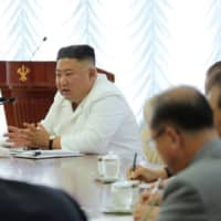 North Korean leader Kim Jong Un speaks during the 13th Political Bureau meeting of the 7th Central Committee of the Workers' Party of Korea in this image released Monday. | KCNA / KNS / VIA AFP-JIJI