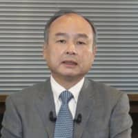 SoftBank Group Corp. Chairman Masayoshi Son on Tuesday speaks in an online conference. | KYODO