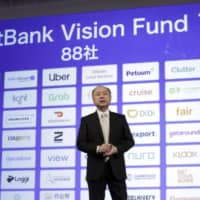 Masayoshi Son, chairman and chief executive officer of SoftBank Group Corp., speaks about the company's Vision Fund operations during a news conference in Tokyo in February.  | BLOOMBERG