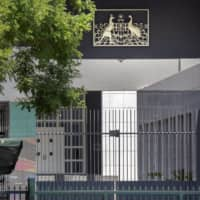 The Australian Embassy stands in Beijing. China's ministry of education warned students on Tuesday there had been 'multiple discriminatory incidents against Asians in Australia' during the pandemic.  | AP