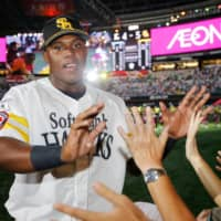 The Hawks' Oscar Colas greets fans after a win over the Lions on Aug. 18 in Fukuoka. | KYODO