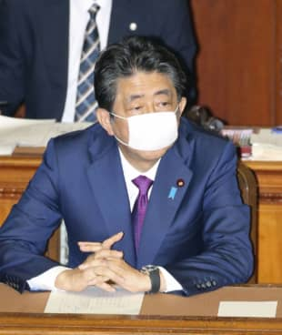 Prime Minister Shinzo Abe attends a House of Representatives plenary session in Tokyo on Wednesday. | KYODO