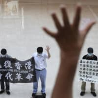 Demonstrators protest against China's national security legislation at a shopping mall in Hong Kong on May 29. | AP