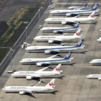 Aircraft are parked at Haneda Airport in Tokyo on April 30 amid the coronavirus epidemic. | KYODO