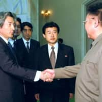 In 2002, then Prime Minister Junichiro Koizumi (left) met with North Korean leader Kim Jong Il in Pyongyang to attempt to resolve the abduction issue. | KYODO