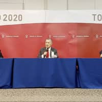 Tokyo 2020 President Yoshiro Mori (center) speaks during a news conference with organizing committee CEO Toshiro Mori (left) and Tokyo 2020 spokesman Masa Takaya on Wednesday in Tokyo. | TOKYO 2020 OFFICIAL YOUTUBE CHANNEL / VIA AP