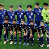 Nadeshiko Japan players pose for a team photo prior to their match against the Netherlands during the 2019 Women's World Cup in Rennes, France. | REUTERS