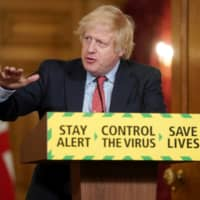 British Prime Minister Boris Johnson speaks during a daily briefing on the coronavirus in London on Wednesday. | HANDOUT / VIA REUTERS
