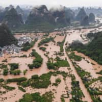 This photo taken on June 7 shows submerged streets and buildings after heavy rain caused flooding in Yangshuo, in China's southern Guangxi region. | AFP-JIJI