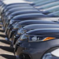 A long row of unsold cars are seen at a Honda dealership in Highlands Ranch, Colorado, on Sunday. | AP