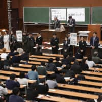 A standardized university entrance exam is held at the University of Tokyo campus in January. | KYODO