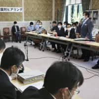 Opposition parties hold a joint hearing in the Diet building Wednesday regarding the outsourcing of work related to a COVID-19 relief program. | KYODO