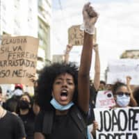 People protest racism and hate crimes during a Black Lives Matter demonstration in Sao Goncalo, Brazil, on June 5.  | AP