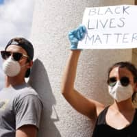 White Americans join Floyd protests, but will they work for change?