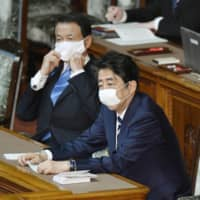 Japan enacts record extra budget to address pandemic fallout