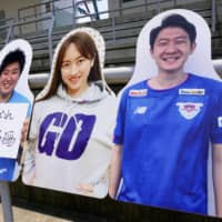 First-division side Sagan Tosu will sell cardboard cutouts bearing likenesses of their fans to be displayed at Ekimae Real Estate Stadium. | SAGAN TOSU / VIA KYODO