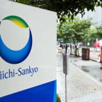 Signage for Daiichi Sankyo Co. is displayed outside the company's headquarters in Tokyo in July 2019. | BLOOMBERG
