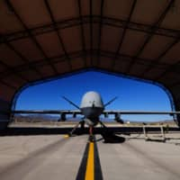 A U.S. Air Force MQ-9 Reaper drone sits in a hanger at Creech Air Force Base in Nevada in May 2016.  | REUTERS