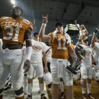 Texas players sing 'The Eyes of Texas' after the Alamo Bowl on Dec. 31, 2019, in San Antonio, Texas.   USA TODAY / VIA REUTERS