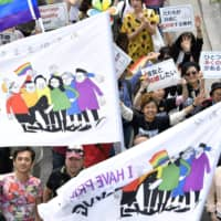 People march in Tokyo's Shibuya Ward during the Tokyo Rainbow Pride 2019 parade in April 2019. | KYODO