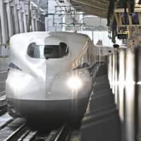 Central Japan Railway Co. 's N700S new bullet train at Tokyo Station Saturday morning prior to a media tour. | KYODO
