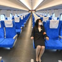 The N700S new bullet train offers more comfort and improved functions for passengers, with a power outlet installed at every seat.  | KYODO