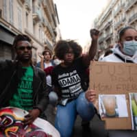 Hawa Traore, sister of Adama Traore, a 24-year-old black man who died in French police custody in 2016, takes part in a rally as part of the Black Lives Matter worldwide protests against racism and police brutality, in Marseille, France, on Saturday.  | AFP-JIJI