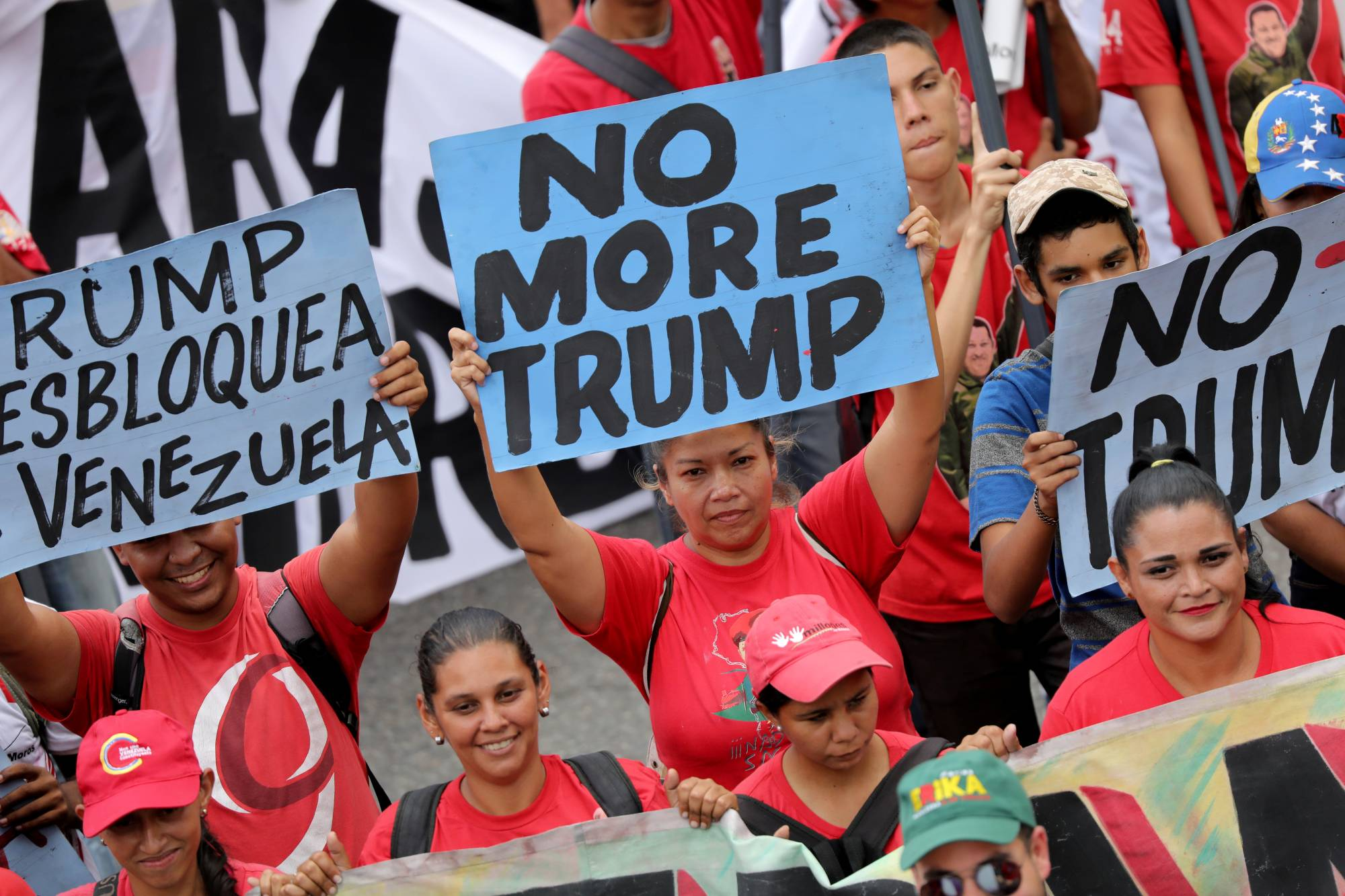 Supporters of Venezuela's President Nicolas Maduro hold anti-Donald Trump banners during a rally against the U.S. sanctions on Venezuela in Caracas in August 2019. | REUTERS