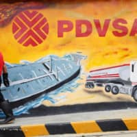 An investigation has found that crude from PDVSA kept arriving at Chinese ports despite U.S. sanctions via a roundabout delivery method that made it appear as if the oil's origin was Malaysia. | REUTERS