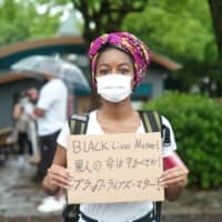 Sierra Todd, founder of Black Lives Matter Tokyo and a student at Temple University, participates in a rally in the capital on Sunday. | RYUSEI TAKAHASHI